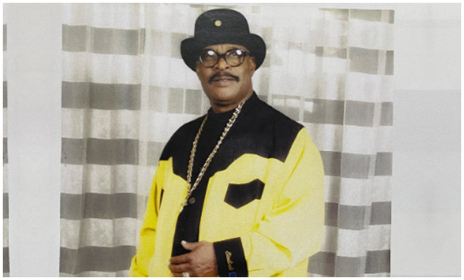 a man wearing yellow jacket and a hat