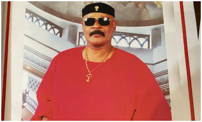 a person with red shirt and black shades