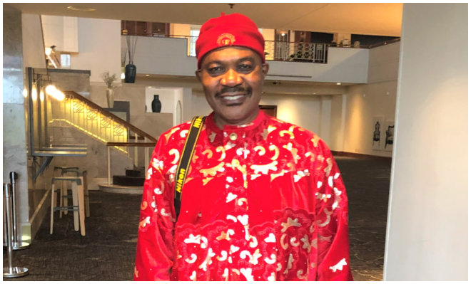 a man wearing red clothes